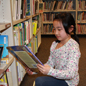 Elementary student looking at a book in the library